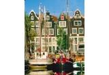 o excursie la New York, 2 x bilete dus-intors la Amsterdam si 2 valize de calatorie, 2 x bilete dus-intors la Amsterdam