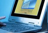 un laptop, un tricou si o carte despre investitii<br type=&quot;_moz&quot; />
