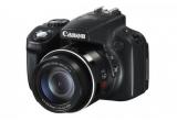 1 x camera foto Canon PowerShot SX50 HS, 1 x geanta frigorifica, 1 x troller inscriptionat Canon