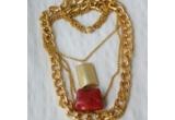 1 x colier din lanturi cu accesorii metalice placate oferit de Zodiac Café