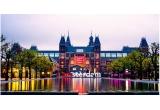 1 x sejur de Revelion la Amsterdam, 12 x city break Amsterdam, 11500 x voucher eMAG de 20 ron