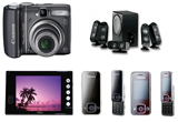 <b>O camera foto Canon PowerShot A590iS, un sistem audio Home Theatre Logitech X350, un mp4 player nJoy PMP-221, doua telefoane mobile</b> <b>Samsung F250</b><br />