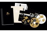 """un pachet special U2 """"Joshua Tree Deluxe"""" (album, CD cu raritati, DVD concert, carte cu poze si versuri)"""